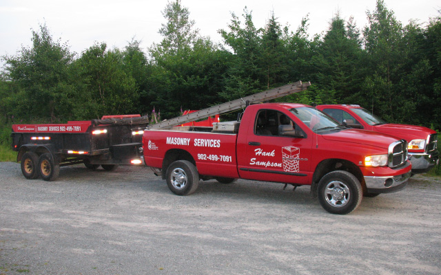 Hank Sampson Masonry trucks with trailers